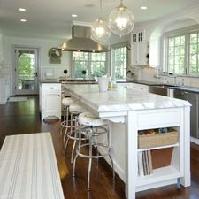 "the stove in the peninsula with a ""floating"" range hood is an interesting idea...wonder if it has a pop-up backsplash"