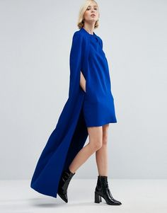 What an amazing blue dress with cape details for holiday outfit