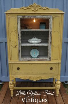 Painted China Cabinet in Mustard Seed Yellow with Edison bulb lighting built in.