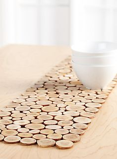 Mosaic of interesting small appliqué wood slices on chocolate brown felt-a charming rustic accent that easily matches traditional and modern decors.