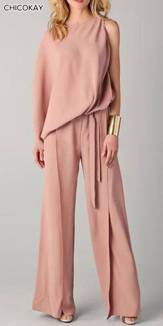 The elegant pure color round neck irregular jumpsuits is so elegant and it suits many occasions. jumpsuit casual,jumpsuit outfit work,how to wear jumpsuit,casual jumpsuit outfit fall Jumpsuit Elegante, Pink Jumpsuit, Jumpsuit Outfit, Casual Jumpsuit, Jumpsuit With Sleeves, Elegant Jumpsuit, Summer Jumpsuit, Sequin Jumpsuit, Wrap Jumpsuit