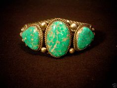 This stunning bracelet features one large oval natural turquoise center stone with a smaller triangular shaped stone on each side. The bracelet has nice hand made silver work in a rope design as the framework of the cuff. | eBay!