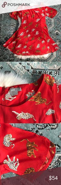 ASOS   Fit & Flare Tiger Dress ASOS   Fit & Flare Tiger Dress. Awesome printed dress. Super flattering fit / skater dress. ASOS Dresses Midi