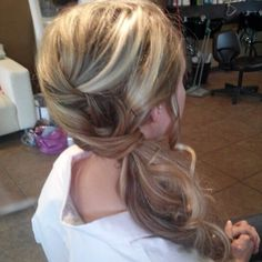 Side pony updo on thick hair. Done by Ali Onken @ Bella's Salon.