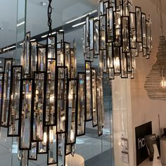 Empire Chandeliers available @beaconlighting comes in either 10lights or 12lights. Inspired by the Art Deco style. It adds a lot of bling to any room. I would install it in the formal living or above our dining table