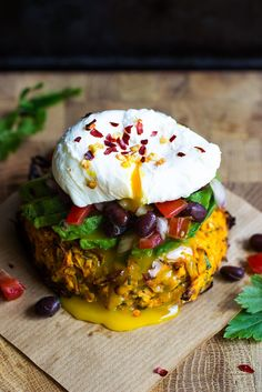 Oven baked sweet potato rosti with black bean salsa, avocado and poached egg