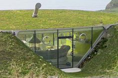 Creative home in the ground idea!