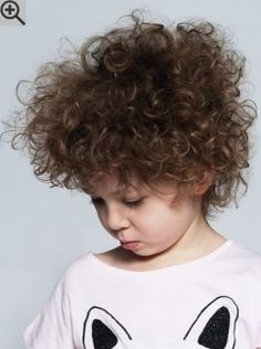 Short haircut for kids with large curls. Layers keep the hair light and easier to take care of.