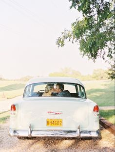 A stunning Southern Equestrian styled wedding photo shoot with the perfect vintage flair at Howell Family Farms. Classic car vintage car bride groom getaway
