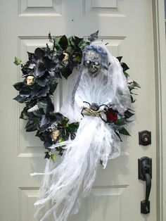 DIA DE LOS MUERTOS/DAY OF THE DEAD~Ghoulish Skeleton Bride Awaiting Her Lover Spooky Wreath by English Rose Designs. $89.99, via Etsy.