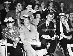 John F. Kennedy surrounded by women voters during his first campaign for congress in 1946. (AP Photo)