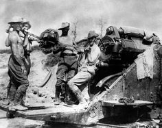 n this 1916 file photo, Australian artillery soldiers operate a large caliber gun at the Somme front, in France during World War One.