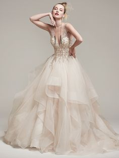Amélie by #SotteroandMidgley   Dione organza creates the dramatic Amelie ball gown with horsehair layered skirt, featuring a breathtaking bodice adorned with Swarovski crystals and pearls, plunging illusion V-neckline and back. Finished with crystal buttons over zipper closure.