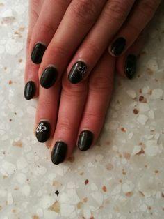 Black nails, extraordinaire decoration in gel uv. Black gel.