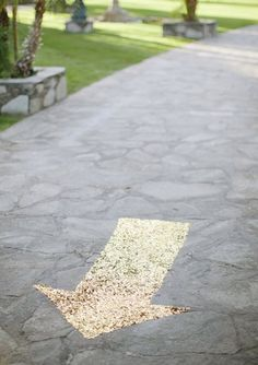 A gold sequined arrow that shows guests where to go. | 23 Unconventional But Awesome Wedding Ideas