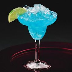 This Moonlight Margarita is a True-Blue Showstopper! Swap in blue curaçao for the usual triple sec and you've got a gorgeous twist on the classic.