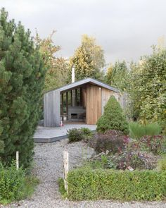The tiny Poplar Garden House by Onix, a gable-roofed structure, available to use in the summer. | Tiny Homes