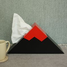 You always wanted your own Volcano, right? This artful and modern tissue box dispenser will add a dynamic and colorful touch to your modern décor – whether it be in a kid's room, a sophisticated livin