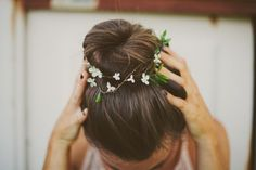 tiny flowers in her hair