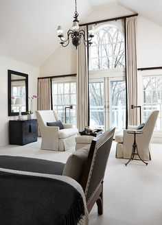 Stephen Knollenberg. Stunning. Perfect way to address this wall of windows. Offers complete coverage for sleeping. Love the black banding and black rods.