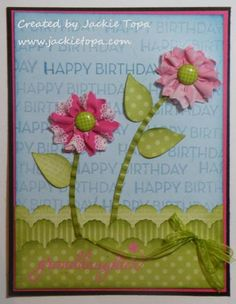 You can cut the fabric on the Tasteful Trim die and use the negative strips on the sides to create your flower.