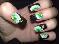 Elegant Nail Art Ideas – Black nail polish for base color and green white flowers with yellow dots