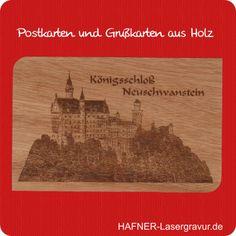 Neuschwanstein auf einer Grußkarte aus Holz. Das Schloss Neuschwanstein ist in die Grußkarte aus Holz eingebrannt.