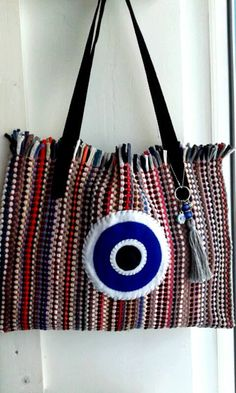 Handmade bag kourelou with big eye and elements by Papa k' Froufrou Corinthos Greece Diy Handbag, Diy Purse, Leather Bag Tutorial, Diy Bags Purses, Handmade Purses, Embroidered Bag, Denim Bag, Handmade Pillows, Knitted Bags