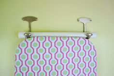 Hang up the ironing board with large coat hooks!