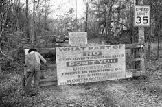 Moonshiner Popcorn Sutton putting up no tresspassing signs in Parrottsville, TN.