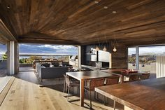 Kitchen facing rear view through living.  Dining on deck. - Genius Loci / Bates Masi + Architects
