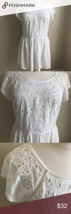 AMERICAN EAGLE OUTFITTERS LACE WHITE DRESS SPRING Super dainty and cute white lace dress, relaxed fit and free flowing, super light weight and great for summer. I would recommend wearing a light colored slip or wear this over leggings. So fun and great for spring! American Eagle Outfitters Dresses Mini