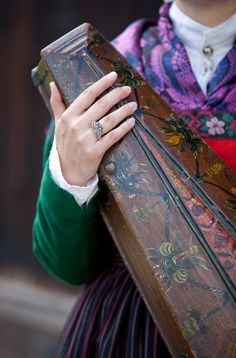 Norwegian fiddles are kept in beautifully decorated wooden boxes.