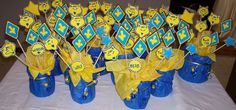 I made these 10 centerpieces for our Blue and Gold Banquet. Most ...