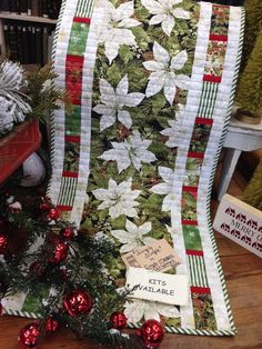 Pretty Christmas fabric and pieced borders.                                                                                                                                                                                 More