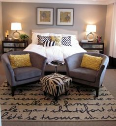LOVE THIS! But, with Red walls, beige comforter and back pillows, and maybe navy accents? (to replace yellow printed pillow on bed,and pillows on chairs) Black chairs, and candles) KEEP the rug, zebra stool, lamps, and set up.