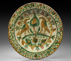 Italian ~ Early 16th century ~ Bologna ~ Museum of Fine Arts, Boston ~ Incised with birds flanking a tree within a surround of radiating motifs, the rim with scale pattern enclosing dots under green and ochre splashed glazes.