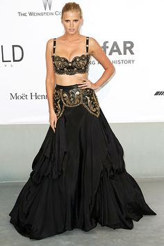The 7 Magpies You Meet At The amfAR Gala     The Gilded Magpie: Lara Stone We haven't seen much of Lara in the spotlight recently, but the Dutch model certainly knows how to remind the world she's a bombshell. Here, an intricate, two-piece, Gianni Versace vintage ensemble does the trick.