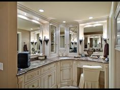 Traditional Master Bathroom with Ms International Emperador Dark Marble, Complex granite counters, Wall sconce, Raised panel