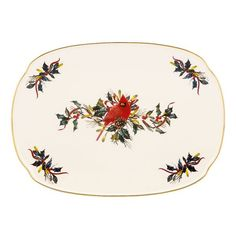 With its generous size and gorgeous artistry, the Winter Greetings Oblong Platter from Lenox is a serving piece you'll use over and over again. At the center of a tray is a handsome cardinal perched among seasonal greenery, courtesy of renowned nature artist Catherine McClung.