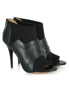 These Daniel Footwear peep toe booties in black have contrast fabric panels, zip fastening to the back and stiletto heels that measure approximately 4 inches Black Is Beautiful, Beautiful Shoes, Sports Luxe, Black Shoes, Stiletto Heels, Peep Toe, Footwear, Booty, Sandals