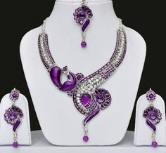 Peacock Indian Jewellery Set With Necklace, Indian Earrings & Maang Tikka Studded with sparkling and shining golden & purple color stones & meenakari all over.