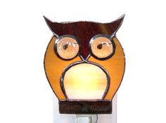 This night light is made of stained glass in a shape of an owl. The owl was made of brown and caramel glass with beige belly and beige eyes. The nightlight was made using the copper foil or Tiffany style method - so no lead came was used. The seams are patinaed into grey color. The owl panel is approximately 4.5 x 5 inches and is attached to a UL Listed Night Light with a 4 watt bulb.  This design is available in other color combinations in my shop http://etsy.me/124cnAu  Upgra...