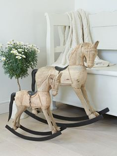 Decorative Wooden Rocking Horses for nursery. I would love to paint one of these.