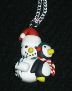 Snowman with cuddly penguin necklace. silver colored chain. by HooksBrushesandBeads on Etsy