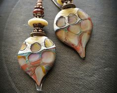 magnificent artisan made ceramic shield droppers with a Polynesian Tapa Cloth design, attached to rusty rings with a crazy glass seed bead wrapping , finished off with copper ear wires.  These are truly a work of art ♥ •Approx. 1.75 total, •very light weight •Unique as you can get! •very earthy and organic •Only at Yucca Bloom♥