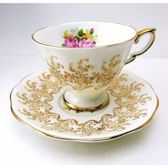 ROYAL STANDARD Golden Rose Bouquet Teacup and Saucer Set Albert Works... (1.015 ARS) ❤ liked on Polyvore featuring home, kitchen & dining and drinkware