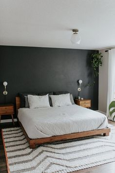 luxury home accents dark accent wall, modern bedroom, midcentury modern bedroom, neutral bedroom, moody bedroom Dark Accent Walls, Accent Wall Bedroom, Bedroom Neutral, Bedroom Yellow, Dark Gray Bedroom, Colourful Bedroom, Dark Bedroom Walls, Marble Bedroom, Bedroom Windows