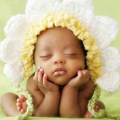 What a sweet little face. :) Beautiful baby