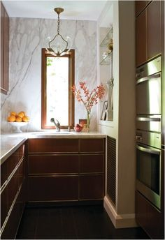 cherry wood contemporary cabinets Love the lighting fixture
